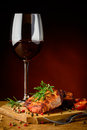 Steak and red wine still life with beef rosemary glass of Royalty Free Stock Photo