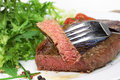 Steak and salad grilled on plate Royalty Free Stock Images