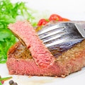 Steak and salad grilled on plate Stock Image