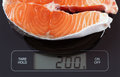 Steak of salmon fish on kitchen scale Royalty Free Stock Photo