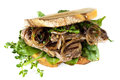 Steak sandwich with caramelized onions and herbs isolated made sourdough bread fresh on white Stock Photos