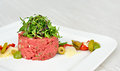 Steak tartar prepared in italian manner with balsamic vinegar from modena and green olives Royalty Free Stock Photos