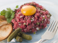 Steak Tartare with Cornichons, Croutons and an Egg Royalty Free Stock Image