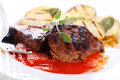 Steak with tomato sauce Royalty Free Stock Photos