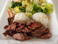 Steak white rice toss salad in a styrofoam plate medium rare chopped with spices local hawaii style lunch Stock Images