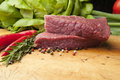 Steak on a wooden board, close up Royalty Free Stock Photo