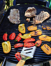 Steaks and peppers on the barbecue Stock Images