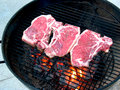 Steaks on the Red Hot Grill Stock Photos