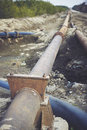 Steal big pipeline on a ground old pipes joint rusted Stock Photos