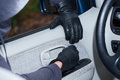 Stealing a car thief wearing black gloves breaking into Stock Photo