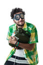 Stealing gas a guy wearing casual clothes and on old pair of goggles over a white bachground and a fuel tank Royalty Free Stock Photography