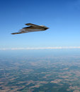 Stealth bomber in flight state of the art flying at high altitude Royalty Free Stock Photos