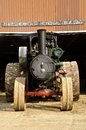 Steam engine parked in front of building Royalty Free Stock Photo