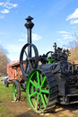 Steam engine powering threshing machine Royalty Free Stock Image