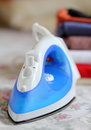 Steam iron and pile of cloth Royalty Free Stock Images