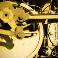 Steam locomotive wheel and rods sepia toned Stock Photo