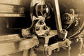 Steam train brake assembly detail of vintage sepia effect horizontal format Royalty Free Stock Photos