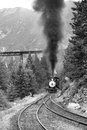Steam train is coming up black and white photography Royalty Free Stock Image