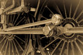 Steam train connecting and piston rods wheels with attached vintage sepia effect horizontal format Royalty Free Stock Photography