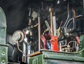 Steam train controls the of a with brake lever in the foreground Royalty Free Stock Photos