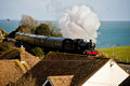 Steam train in south devon along the cost Royalty Free Stock Image