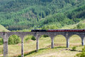 Steam train on a viaduct Royalty Free Stock Image