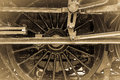 Steam train wheel connecting rods assembly detail showing and piston vintage sepia effect horizontal format Royalty Free Stock Photography