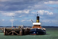 Steam tug at pier Royalty Free Stock Photos