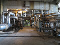 Steam turbine, machinery, pipes, tubes at power plant Royalty Free Stock Photo