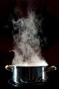 Steam water vapor over cooking pot Royalty Free Stock Photography