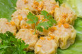 Steamed Chinese Dumpling Shumai served in Thai style with fried garlic Royalty Free Stock Photo