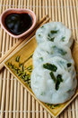 Steamed dumpling stuffed with garlic chives chinese chives served sweet black sauce Stock Images