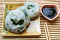 Steamed dumpling stuffed with garlic chives chinese chives served sweet black sauce Royalty Free Stock Photo