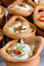 Steamed fish with curry paste and coconut milk topping in clay pot Royalty Free Stock Images