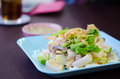 Steamed fish on dish with fried garlic and fresh vegetable Royalty Free Stock Photography