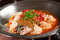 Steamed fish head with diced hot red peppers Stock Image