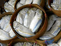 Steamed mackerel fish on the bamboo round basket Royalty Free Stock Photo
