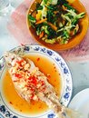 Steamed red snapper with garlic and chili lemon sauce sautéed vegetables in fish sauce Stock Photos