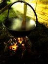 Steaming cauldron a shoot from a caouldron making tradicional hzngarzan food Stock Image