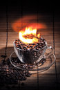 Steaming cup of coffee on fire Royalty Free Stock Photo