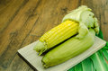 Steaming fresh corn on wooden table Royalty Free Stock Photo