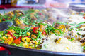 Steaming hot paella, seafood, rice and vegetables in French mark Royalty Free Stock Photo