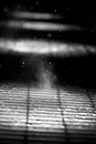 Steaming metal grate a with snow Royalty Free Stock Photo