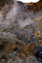Steaming mud holes seltun iceland the alien landscape and rocky coloured mineral deposits of Royalty Free Stock Photo