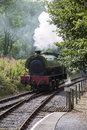 Steaming round the bend nostalgic steam train rounding a in full steam Stock Photo