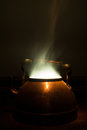 Steaming tea kettle vintage in the dark Royalty Free Stock Photos
