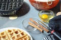 Steaming waffle iron making waffle, bowl of batter Royalty Free Stock Photo