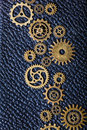 Steampunk mechanical cogs gears wheels on leather background Royalty Free Stock Photo