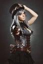 Steampunk woman aiming with gun