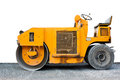Steamroller yellow and cement road with white background Stock Images